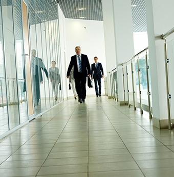 c-suite executives walking down hall