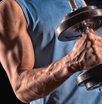 man's arm lifting weights