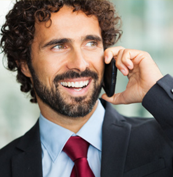 male executive with beard on the phone