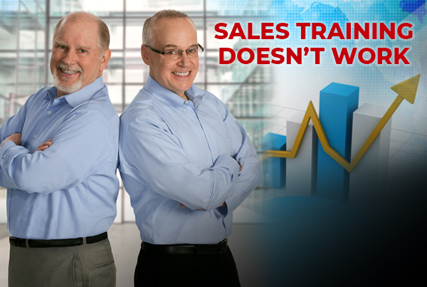 Paul Cherry & Patrick Connor in front of sales graph